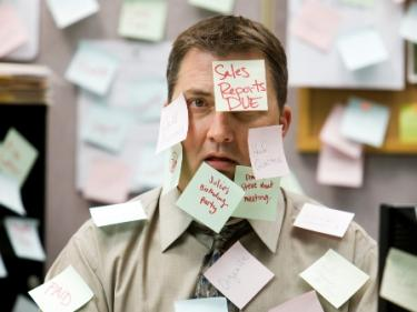 businessman_post-its_busy_work_stress_iStock_3x4-375x281